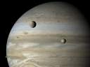 Europa and Io in front of Jupiter